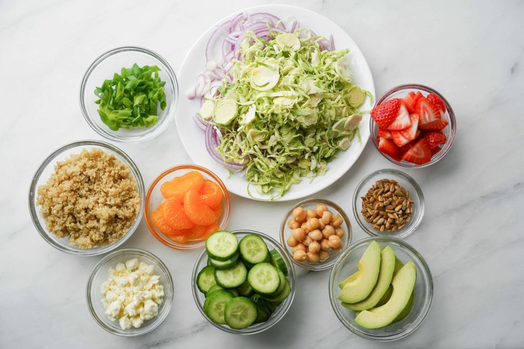 veggies, fruit, grains, and fats for salad