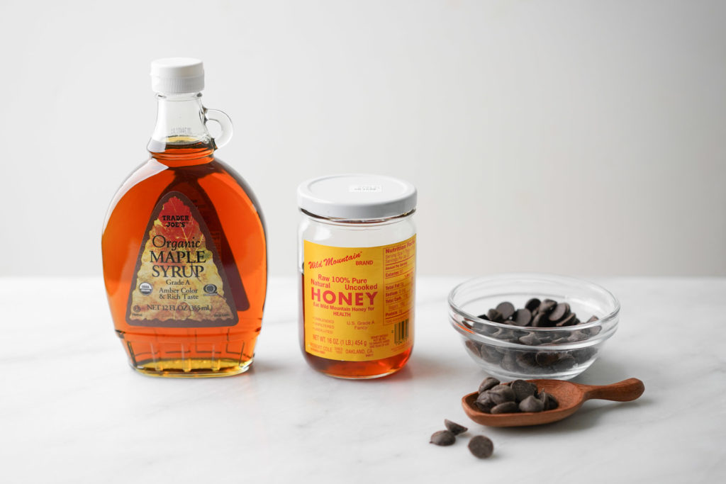 maple syrup bottle, honey jar, chocolate chips
