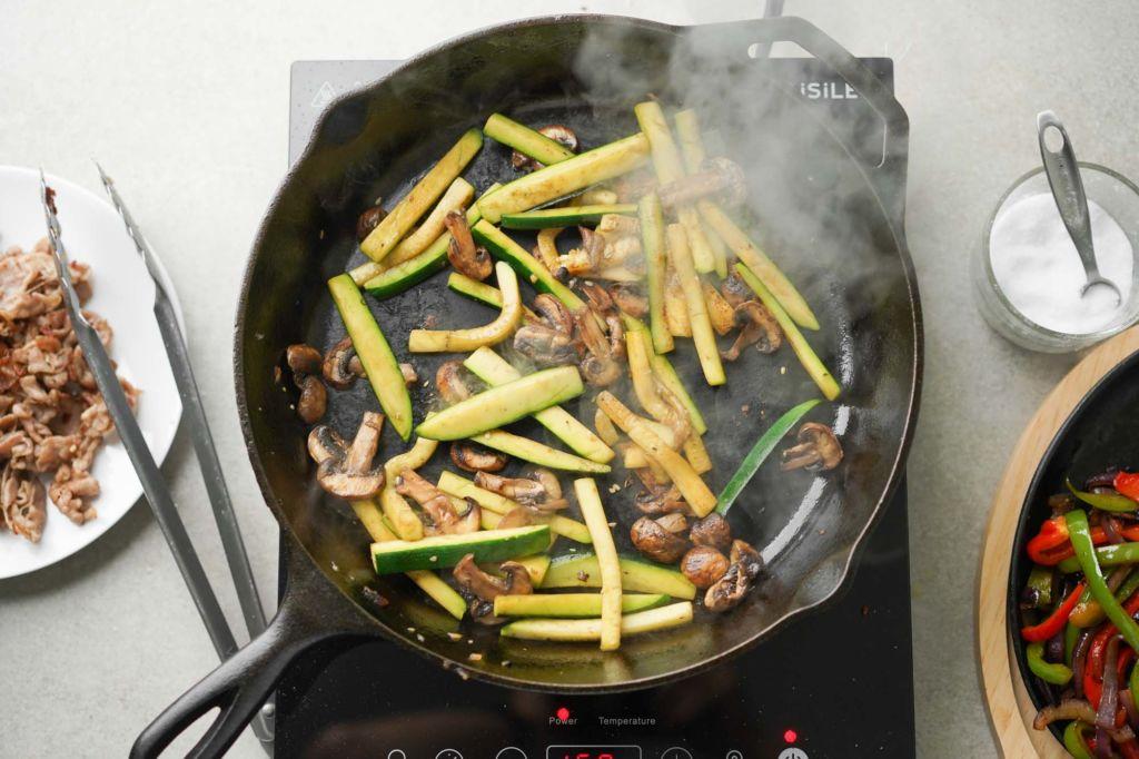 sauteeing zucchini and mushrooms