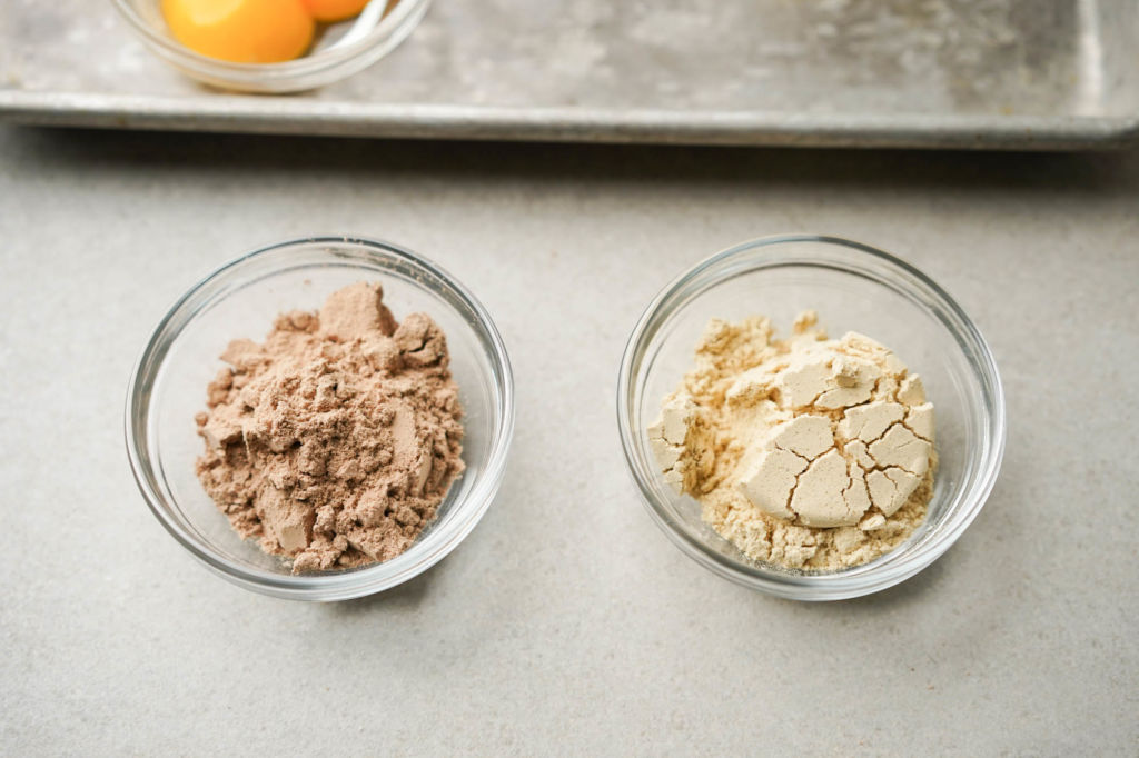 scoops of chocolate and vanilla protein powder