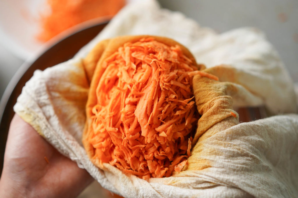 shredded sweet potato in cheesecloth