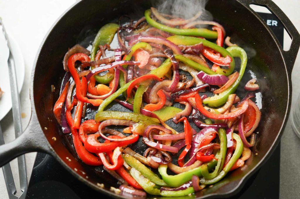cast iron skillet with steamy fajita veggies