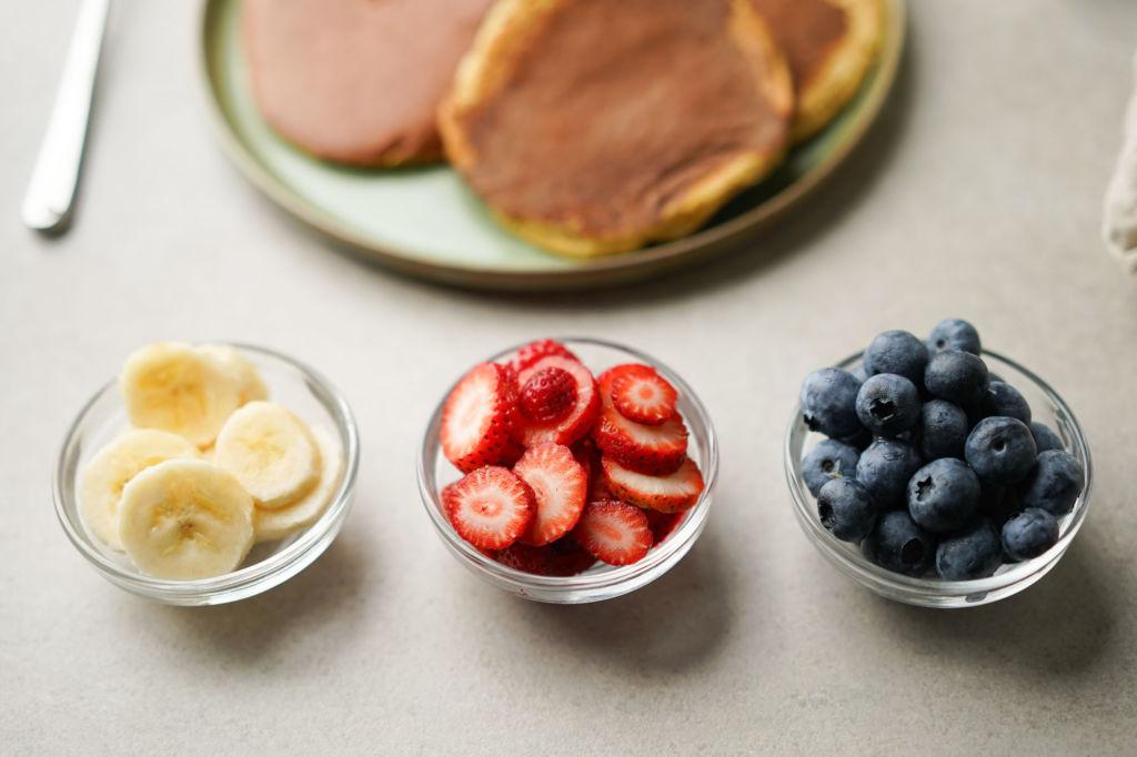 sliced banana, strawberries and blueberries