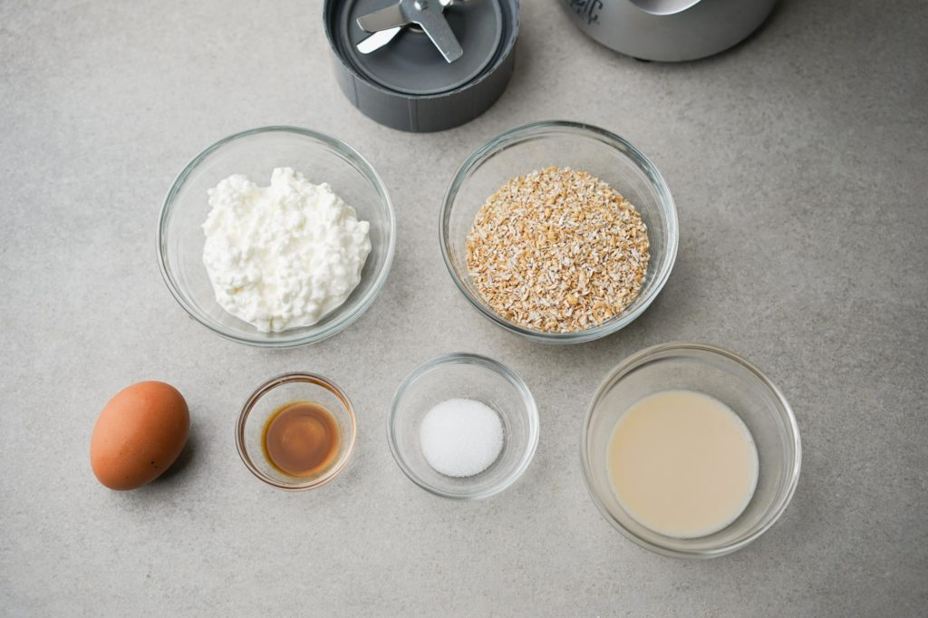 protein waffle ingredients: cottage cheese, oats, egg, vanilla, sugar, plant-based milk