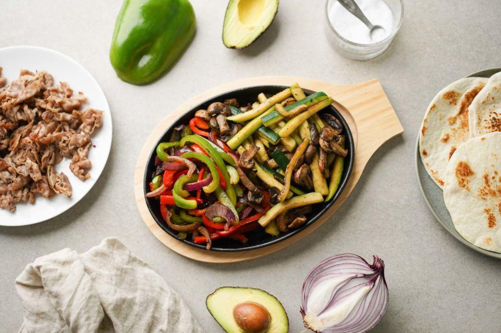 fajita veggies on cast iron skillet