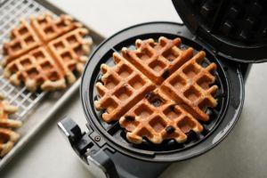 oatmeal waffle in hot waffle iron