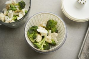 broccoli and cauliflower in salad spinner