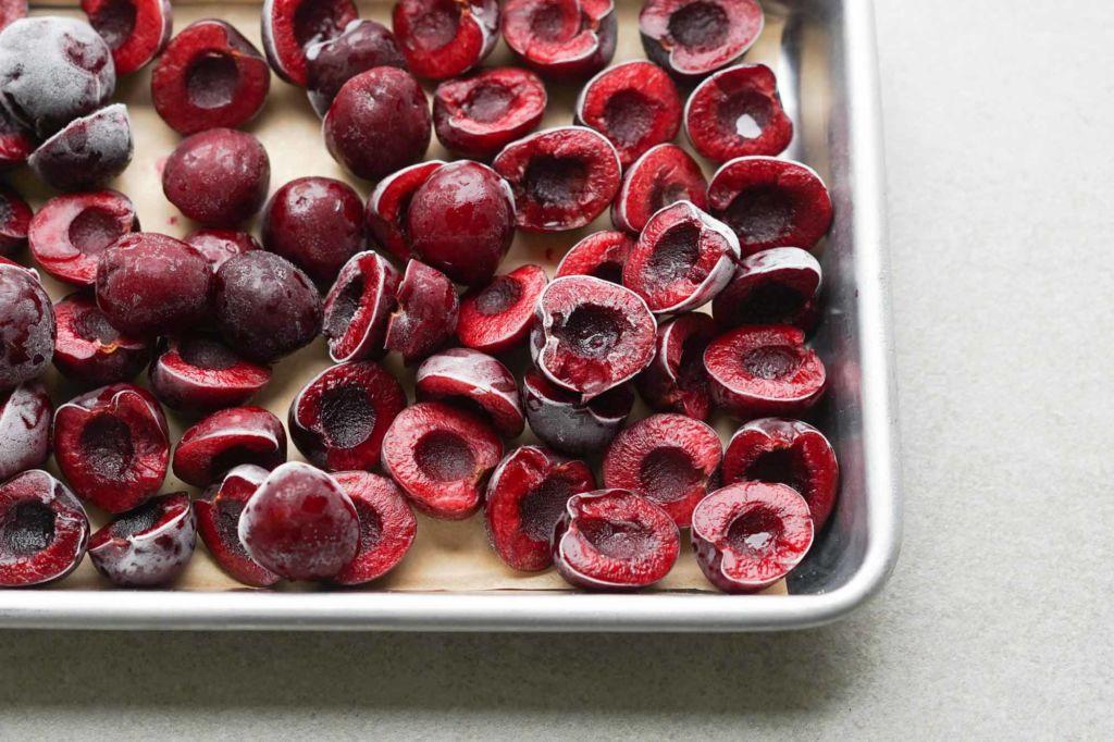 frozen cherries on baking sheet