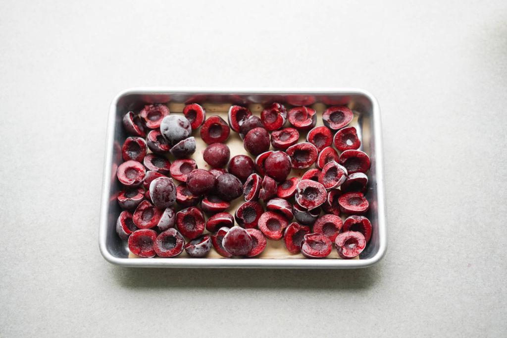 frozen cherries on aluminum tray