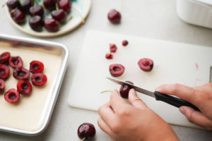 pitting cherries with a knife