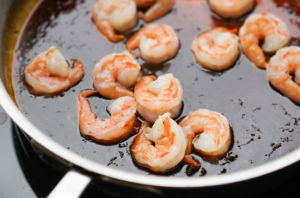 shrimp added to sauced pan