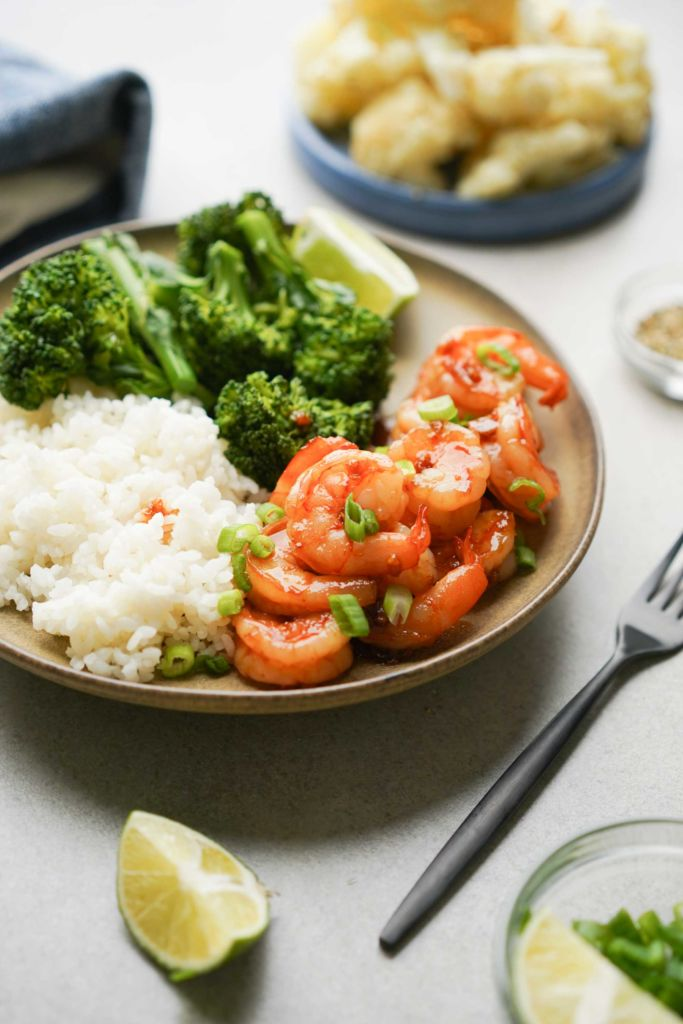 sriracha shrimp plate with rice and broccolini
